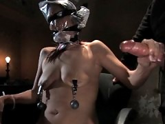 Sexy shaved girl, bound and foced to cum in dirty rundown room.