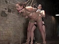 Girl endures intense BDSM session.