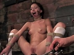 Petite brunette tied up, flogged, and shocked