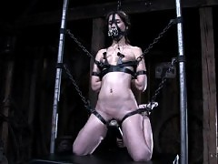 Bondage model Amber Rayne chained and flogged to intense orgasm