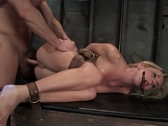 Blonde girl is dominated with sex in bondage