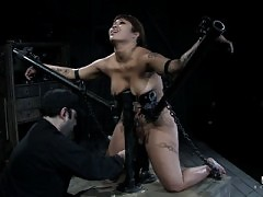 DragonLily in severe hardcore bondage session.