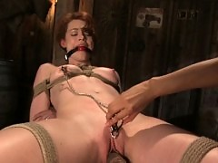 Red head girl in lesbian BDSM sex.